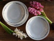 Mid Century Modern Plates With Floral Pattern And Hyacinth Flowers On A Table
