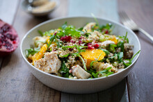 Salad With Buckwheat, Orange And Pomegranate Seeds, Chicken And Halloumi