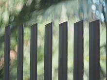 Bokeh Shot Of Vertical Privacy Bars
