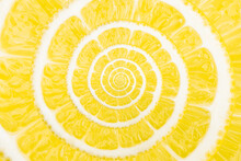 Spiral Natural Fruit Fractal Image. Top View Of Textured Ripe Slice Of Lemon Citrus Fruit With Spiral Endless Skinned.
