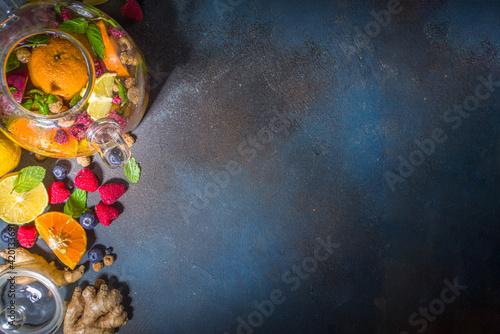 Fototapeta Fruit and berry tea in teapot