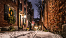 Acorn Street In The Snow With The American Flag Flying