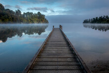 Forest Lake With Little Jetty On A Misty Morning. South Island, New Zealand.