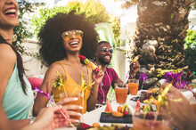 Multiracial Group Of Friends Having Fun At Backyard Home Party - Young People Laughing Together Drinking Cocktails At Bar Restaurant - Focus On Black Woman
