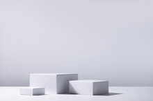 Elegant Abstract Set Of White Podiums In Sunlight With Shadow On White Background For Product Display. Simple Modern Geometric Design.