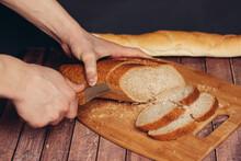 Cutting A Fresh Loaf On A Cutting Board Crispy Bread Kitchen Meal