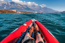 Legs Of A Woman In A Kayak With Mountains In A Background In Bay Of Kotor