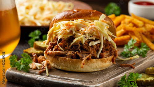 Fototapeta Homemade BBQ Pulled Pork burger with coleslaw, fries and beer obraz