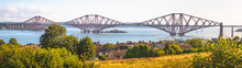 Wide Panorama View Of The Iconic 19th Century Forth Rail Bridge Queensferry Crossing Over The Firth Of Forth On A Sunny Day Near Edinburgh, Scotland.