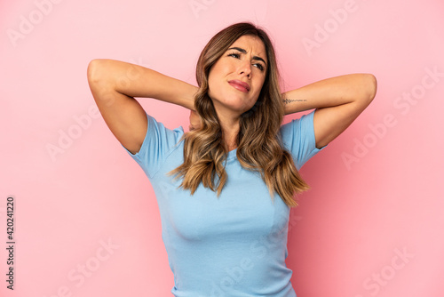 Young caucasian woman isolated suffering neck pain due to sedentary lifestyle.