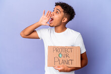 Young African American Curly Man Isolated Holding A Protect Our Planet Shouting And Holding Palm Near Opened Mouth.