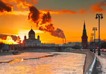 Building Of The Cathedral Of Christ The Saviour, Kremlin Tower And Moskva River. Winter Sunset. Moscow. Russia