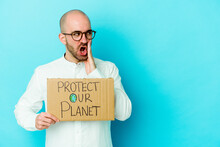Young Caucasian Bald Man Holding A Protect Our Planet Placard Isolated On Purple Background Is Saying A Secret Hot Braking News And Looking Aside