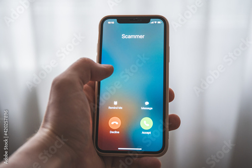 Obraz na plátně Incoming call from Scammer. Scam on phone and online