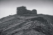 Black And White Photo Of The Old Observatory On The Top Of The Mountain