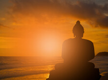 Abstract Buddha Silhouette On Golden Sunset Background Beliefs And Beliefs Of Buddhism