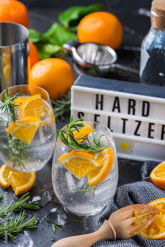 Hard seltzer cocktail with orange, rosemary and bartenders accessories Fotobehang