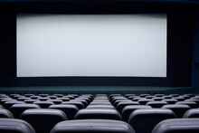Blank Screen And Black Seats In Cinema Hall.