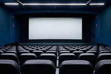 Spacious Cinema Hall With Blank Screen And Rows Seats.