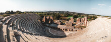 Roman Odeum Of Nicopolis Ancient Cultural Landmark In Greece. Marble Historical Theater Construction, Panorama From Stairs On Stage In Center. Travel Europe