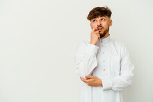 Young Moroccan Man Wearing A Typical Arab Clothes Isolated On White Background Relaxed Thinking About Something Looking At A Copy Space.