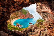 Beautiful Magical View Of The Gyali Beach In Corfu, Greece Through A Hole In The Rock. Amazing Places. Popular Tourist Atraction.