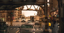 Metal Structure Of The Train Tracks, On The Streets Of New York. Under The Roads The Traffic And People Circulate Normally.