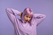 Tired Sleepy Woman Yawns. Girl Stretches Hands Up. Very Boring, Uninteresting. Violet Studio Background.