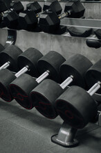 Close Up Of Some Dumbbells. Shelf With Dumbbells In The Gym
