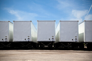 Row of transport truck trailers in a yard