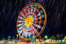 Ferris Wheel At Night In Batumi, Georgia (long Exposure With Star Trails In The Night Sky)