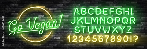 Fototapeta Vector realistic isolated neon sign of Go Vegan with easy to change color font alphabet for decoration and covering on the wall background. Concept of vegetarian cafe and eco product. obraz