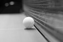 Table Tennis Ball On The Table Next To The Net