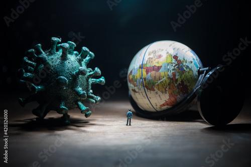Obraz Defocused Businessman standing with corona virus or covid19 in cloudy background, Corona virus pandemic outbreak global crisis, Blurred or defocus technic - fototapety do salonu