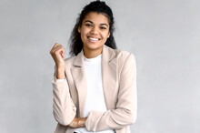 Portrait Of Elegant Happy Business Woman Or Student In Stylish Formal Suit. Beautiful Young Female Is Standing On Isolated Background, Looking Directly At The Camera, Smiling