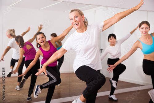 Fototapeta Cheerful different ages women learning swing steps at dance class