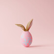 canvas print picture Creative easter egg with rabbit ears on pastel pink background. Minimal concept. 3d rendering