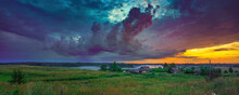 Panoramic View On Dramatic Sunset Over Lake And Old Village In Countryside