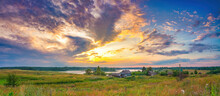 Panoramic View On Bright Sunset Over Lake And Old Village In Countryside