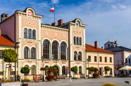 Fototapeta City hall building with colorful town tenement houses at historic city center market square in Zywiec, Silesia region of Poland obraz