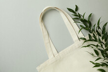 Eco Bag And Twig On Light Gray Background