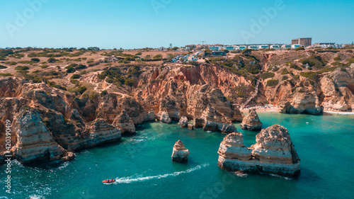 Fotografie, Obraz Aerial view of a blue wonderful sea and buildings on top of the coastal cliffs i