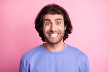 Photo Of Cheerful Charming Young Man Make Beaming Funky Smile Positive Isolated On Shine Pastel Pink Color Background
