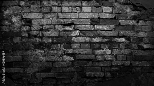 Foto Black old brick wall