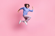 Full Size Photo Of Young Happy Excited Crazy Positive Good Mood Man Jump In Victory Isolated On Pink Color Background