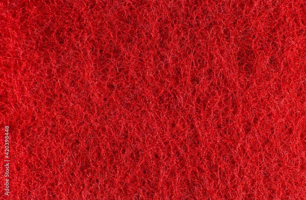 Fototapeta Red sponge texture background. Close up, macro photo.
