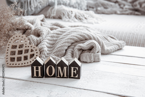 Obraz Cozy composition in Scandinavian style with decorative word home and decor details close up. - fototapety do salonu