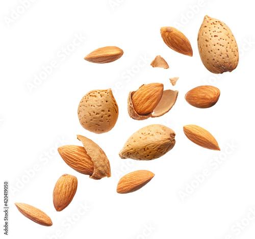 Obraz na plátne Group of almonds splashing over white background