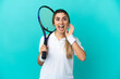 Young woman tennis player isolated on blue background with surprise and shocked facial expression