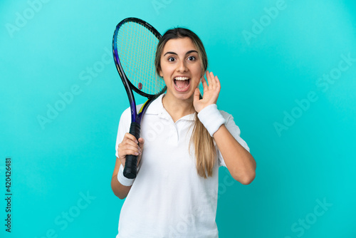 Obraz Young woman tennis player isolated on blue background with surprise and shocked facial expression - fototapety do salonu